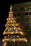 Christmas Tree on Building. Christmas tree on city building lit up at night Stock Image
