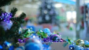 Christmas Tree and bulbs at store stock video footage