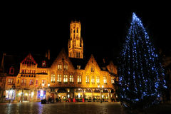 Christmas Tree At Burg Square. Night picture of Christmas tree situated in the Burg square Bruges Belgium showing typical buildings with lights and decorations Royalty Free Stock Image