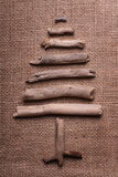 Christmas tree on burlap Stock Images