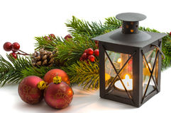 Christmas tree and burning lantern Royalty Free Stock Images