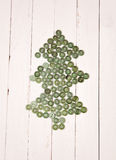 Christmas tree from buttons on a white background wooden table. Christmas tree from buttons on a background wooden table Stock Image