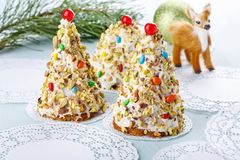 Christmas tree cake in festive decoration.  Three cupcakes in form of Christmas tree royalty free stock photos