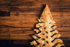 Christmas tree cake on wooden table Royalty Free Stock Image