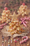 Christmas tree cakes. On a wooden table Stock Photos