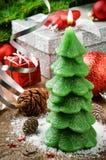 Christmas tree candle on festive background Stock Photos