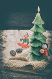 Christmas tree candle in festive retro setting Royalty Free Stock Photography
