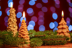 Christmas tree candle flame on blur background Stock Photo