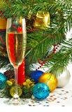 Christmas tree, candle and glass of champagne Stock Photos