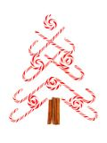 Christmas tree of candy canes and peppermint swirls over white Royalty Free Stock Images