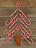 Christmas tree of candy canes and peppermint swirls over wood Royalty Free Stock Photography