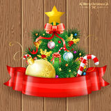 Christmas Tree. With Candy, Fir Branches, Mistletoe and Gift in Red Ribbon on Wooden Boards background, vector illustration Royalty Free Stock Images