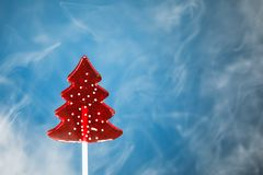 Christmas tree candy in ice fog stock photo