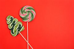 Christmas tree candy and round lollipop on a red background. stock photo
