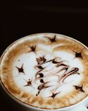 Christmas tree cappuccino art, top view, dark background. Christmas decoration on cappuccino foam Royalty Free Stock Photography