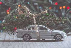Christmas tree on car. Small toy car stock image