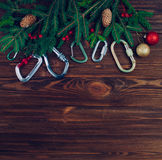 Christmas tree with carabiners over wood background Stock Photo