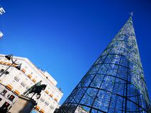 Christmas tree and Carlos III statue in Puerta del Sol square in Madrid, Spain stock photo
