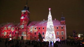Christmas tree at Castle Square in Warsaw, Poland. Crowd around Christmas tree decorated for holidays at square near The Royal Castle stock video