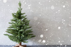 Christmas Tree With Cement Wall As Background, Copy Space, Snowflakes Stock Photography