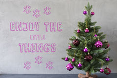 Christmas Tree, Cement Wall, Quote Enjoy The Little Things Royalty Free Stock Photography