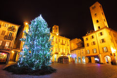 Christmas tree on central plaza. Alba, Italy. Illuminated Christmas tree on central plaza in historic part of town of Alba, Italy Stock Images