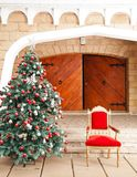 Christmas Tree And Chair Royalty Free Stock Image