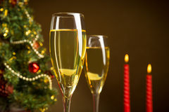 Christmas tree, Champagne, and candle Stock Photos