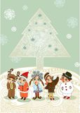 Christmas tree and children. In fancy dress . Christmas Card Royalty Free Stock Images