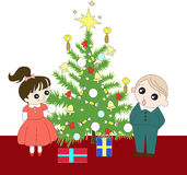 Christmas tree with childrens Stock Photos