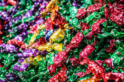 Christmas tree chocolate candies. With snowflakes, on a colorful display in a shop Royalty Free Stock Photo