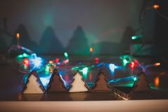 Christmas tree chocolate shapes at garland blurred background stock photos