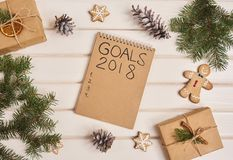 Christmas tree, christmas boxes with notebook and goals for new Stock Images