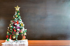 Christmas tree and Christmas decorations on chalkboard background with. Christmas tree decorated with balls, golden star, bell background is chalkboard. concept Royalty Free Stock Image