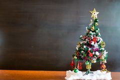 Christmas tree and Christmas decorations on chalkboard background with. Christmas tree decorated with balls, golden star, bell background is chalkboard. concept stock photos