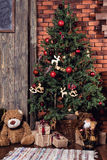 Christmas tree and Christmas decorations. Chalkboard mock up with Christmas gifts and rustic decorations. Christmas tree and Christmas decorations stock photo