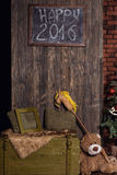 Christmas tree and Christmas decorations. Chalkboard mock up with Christmas gifts and rustic decorations. Christmas tree and Christmas decorations stock photography