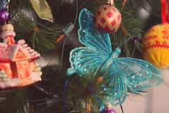 Christmas tree and christmas decorations close up photo. Tinted Stock Photography