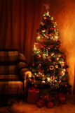 Christmas Tree and christmas gift boxes in the interior Stock Photos