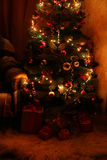Christmas Tree and christmas gift boxes in the interior,lights Royalty Free Stock Photos
