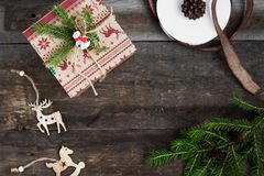 Christmas tree, Christmas gift and Christmas decorations on a wooden background Stock Photography