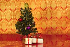 Christmas tree with christmas gifts in red Royalty Free Stock Photography