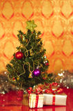 Christmas tree with christmas gifts red vertical Stock Photo