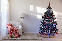 Christmas tree with Christmas gifts in White Hall on Christmas. 1 Royalty Free Stock Photo