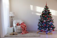 Christmas tree with Christmas gifts in White Hall on Christmas. 1 Royalty Free Stock Photos