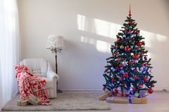 Christmas tree with Christmas gifts in White Hall on Christmas. 1 Stock Photo