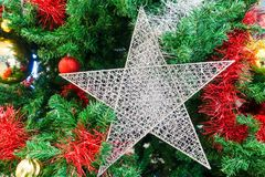 Christmas tree and christmas ornaments. The annual Christian festival celebrating Christ`s birth, held on December 25 in the Western Church Royalty Free Stock Image