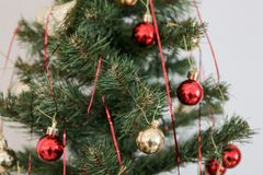 Christmas tree and christmas ornaments. A thing used to make something look more attractive but usually having no practical purpose, especially a small object stock photography