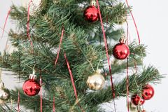 Christmas tree and christmas ornaments. A thing used to make something look more attractive but usually having no practical purpose, especially a small object stock image