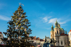 Christmas tree and The Church of St Nicholas, Prague, Czech Republic Royalty Free Stock Photography